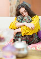 upset girl couch portrait