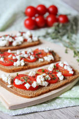 Tomato bruschetta with feta cheese and thyme