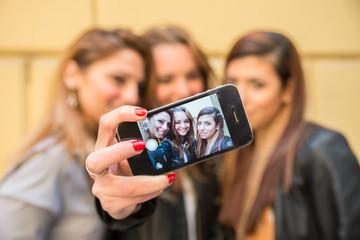 Girlfriends taking a self portrait