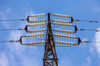 High voltage electric tower against blue sky