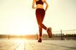 Runner feet running on road closeup on shoe. woman fitness sunri - 72460542