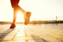 "Постер, картина, фотообои ""Runner feet running on road closeup on shoe. woman fitness sunri"""