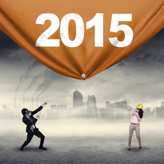 Business people dragging number 2015