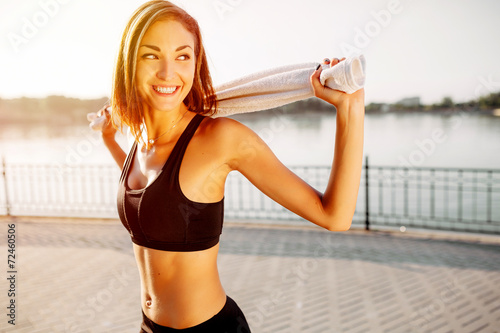 Portrait of an athletic girl. Beautiful young sport fitness mode - 72460506