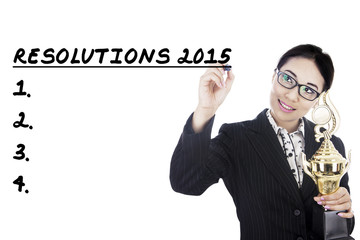 Businesswoman writes her resolutions in 2015