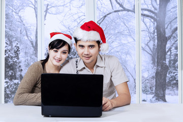 Couple using laptop in winter day