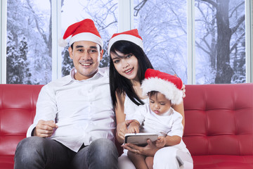 Family with christmas hat on couch
