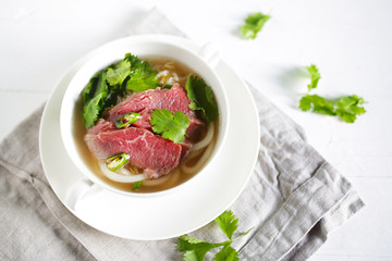 Beef noodle soup with noodles, pho from vietnam with coriander