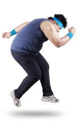 Full length of fat man exercising 2