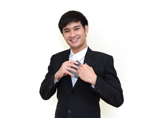 Handsome businessman reaching into his coat pocket to get his wa