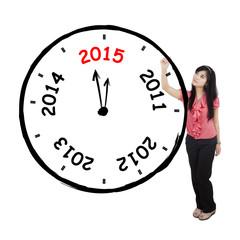 Pretty woman drawing annual clock