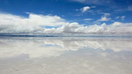 Panorama of the reflecting surface of the lake Salar de Uyuni