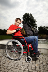 Man on wheel chair - day in park