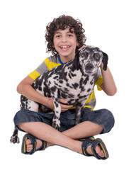 Child petting female dalmatian dog