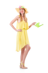 Woman in yellow dress with watering can