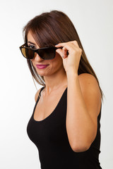 Sexy brunette wearing sunglasses