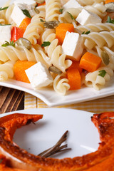 Baked pumpkin and pasta with feta close-up