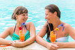 two friends laughing and joking in the pool