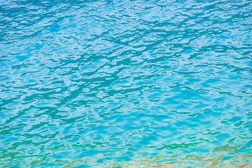 turquoise clear water with small waves