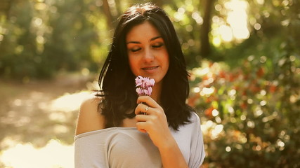 Young woman feeling romantic with flowers