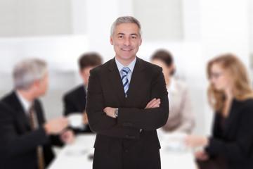Senior Businessman Standing Arms Crossed
