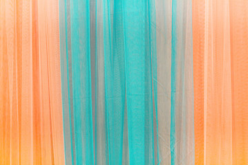 Close up of curtain blue and orange.Can be used as background