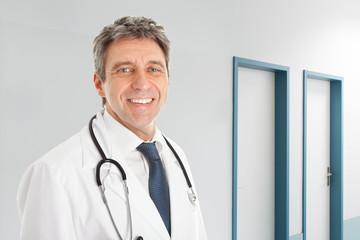 Senior Doctor Smiling In Hospital