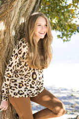 Young beautiful girl laughing, outdoor portrait