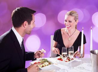 Couple Enjoying Candlelight Dinner At Restaurant