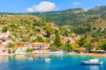 Colorful houses of Assos port and boats on sea, Kefalonia island