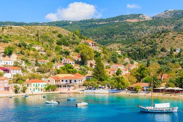 Colorful houses of Assos port and boats on sea, Kefalonia island
