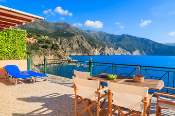 Chairs with table on terrace with sea view on Kefalonia island