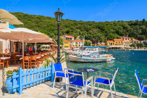 Chairs and tables in restaurant in Kioni port, Ithaka island - 72469307