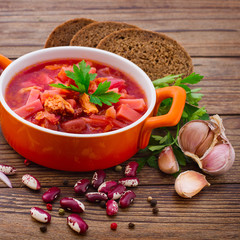 Ukrainian and Russian national Red Borscht on wooden table