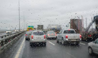 Defocussed traffic viewed through a car windscreen covered