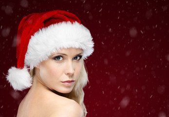 Pretty woman in Christmas cap, purple background