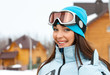 Portrait of female skier thumbing up