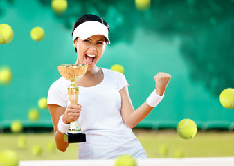 Girl tennis player won the cup at the sport competition
