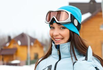 Portrait of female skier thumbing up