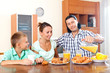 adult couple with a teenager during breakfast