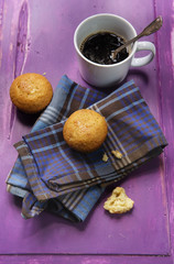 cupcake with cup of coffee on old wooden purple background