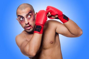 Badly beaten boxer isolated on white