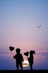 children with hearts balloons