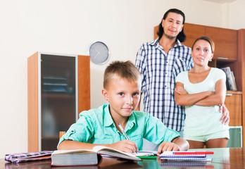 Teenager schoolboy doing homework