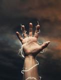 Lightning around men's hand