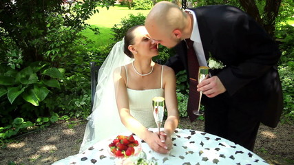 bride and groom drinking champagne 2