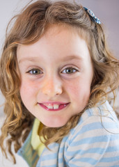portrait of small smiling girl