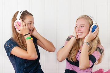Teenager girls with headphones