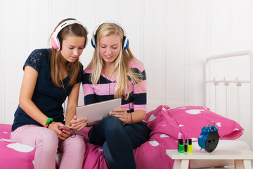 Teenager girls with tablet and smartphone