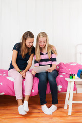 Teenager girls with digital tablet